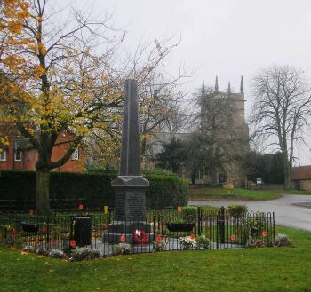 The Village War Memorial with St Andrew's in the background.