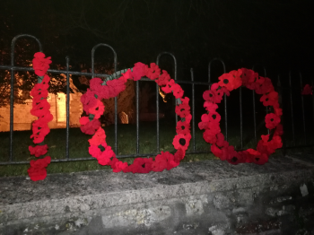 Knitted poppies outside Clutton Church