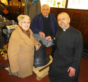 Mr and Mrs Harvey with the Revd Ian Cardinal before the dedication service for the bells.
