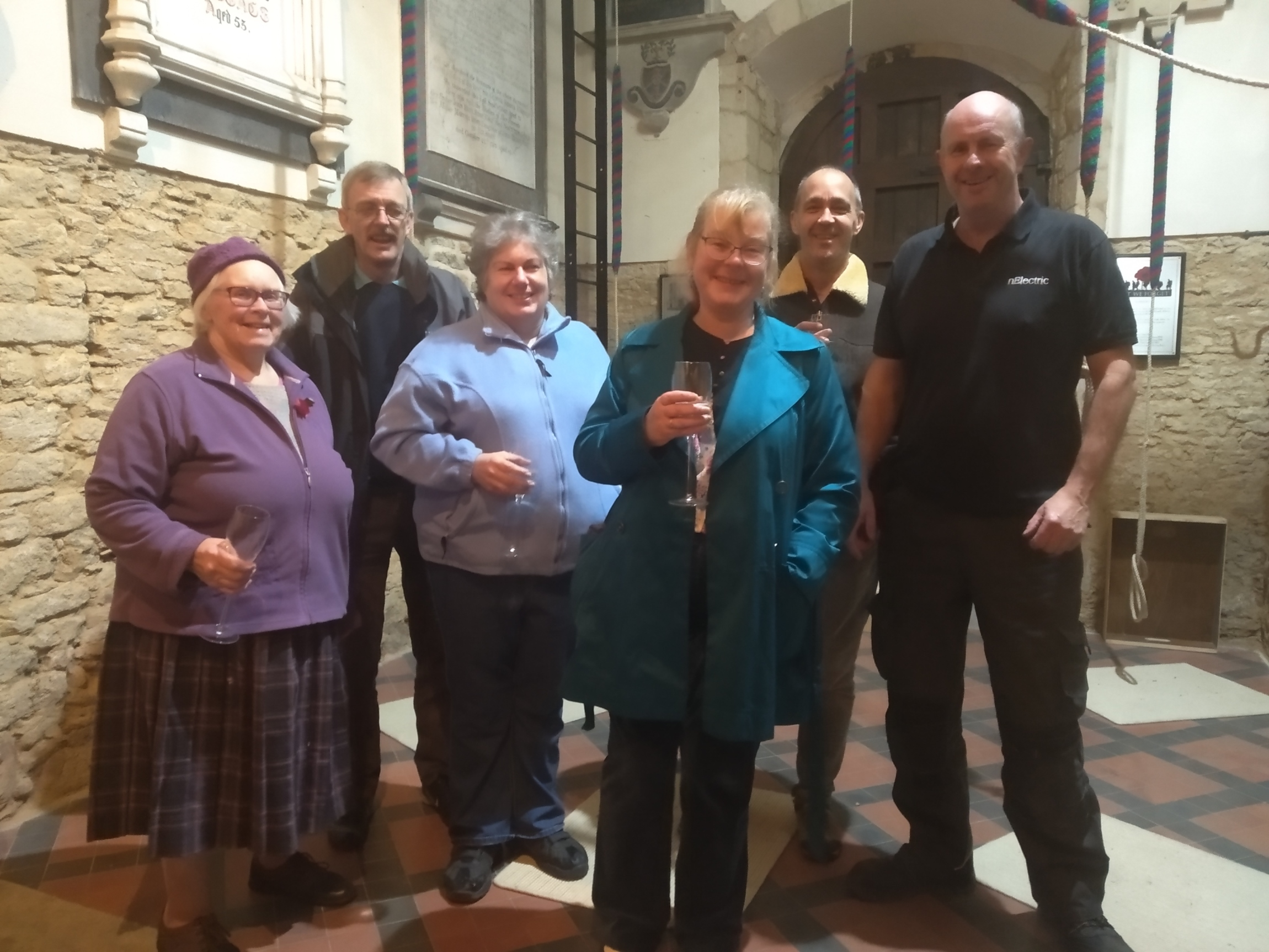 Marion Robinson, Iain Hayden, Angela Whiteway, Sue Marsden, Steve Millington and Nick Elks enjoying a glass of fizz to celebrate Angela's first peal, the first peal on the recently augmented bells and Nick's birthday