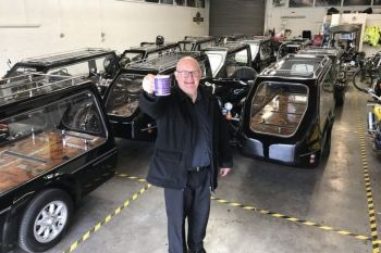 Rev Paul Sinclair and his 16 motorbike sidecar hearses.