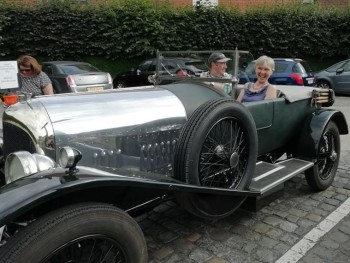 Lesley Boyle being taken for a spin in one of the Bentley's after the quarter.