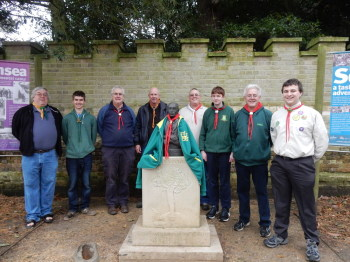 The band in order from left to right, with the bust of Robert Baden Powell, who founded the Scouting Movement in 1907