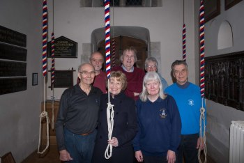 The band in ringing order anti-clockwise from front left, with Annie Spracklen (centre front) to whom the new treble is dedicated.