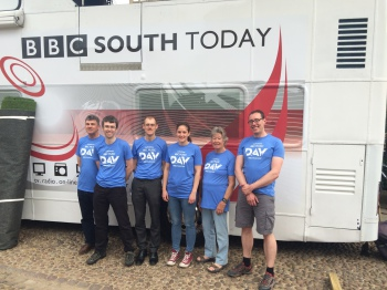 The band in front of the BBC bus.