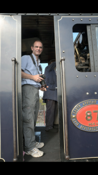 Gareth, camera in hand, on the footplate on the Welsh Highland Railway.