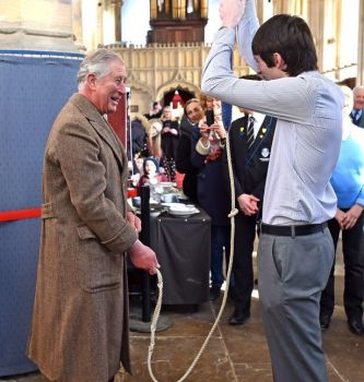 Prince Charles ringing the backstrokes on the third bell at Tattershall, supervised by Chris Woodcock.