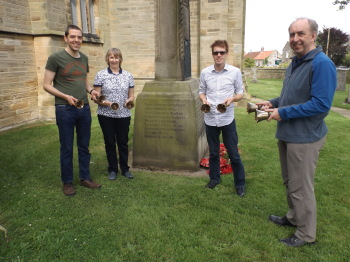 The peal band by the war memorial on which Richard Duck's name is recorded: Johny Stokoe, Jennie Town, James Holdsworth and Peter Sanderson