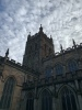 Great Malvern Priory with its huge tower reaching for the fluffy clouds.