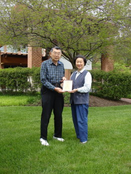 Paul and Kyoko Okamoto, proudly holding their quarter-peal certificate, outside their home in Silver Spring, Maryland, in April 2012. A quarter-peal of 1350 Grandsire Caters had been rung at Southgate a couple of weeks earlier to mark the 40th anniversary of the Washington Toho Koto Society, which they founded in 1972.