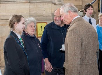 Prince Charles being presented to the youngest ringer Bryony aged 13 and the oldest ringer Joan aged 85.
