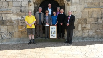 Left to Right: Martin Hardgrave, Roger Dennison (Nephew of Fred) Alison (Rogers wife) Stuart Raggett, Charlie Thorpe (With plaque showing the three service men from this tower killed in WW1) Sue Webb, Tony Dawson and Clive Whiteley
