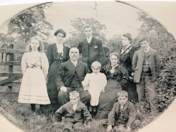 The Hakes family. John is the boy sat at the front on the left. (his brother William is sat on the right, who was also a ringer and died in Oct 1917). John Senior (their father) and Frank & Alfred (their brothers) were also ringers.