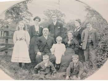 This is the only known surviving picture of John and William Hakes, together with their mother Mary, father John and siblings Mary, Sarah, Frank, Alfred, Eva and Ruth. (Their other sibling Louie died as a child). John and William are the two young boys sat on the ground, William on the right and John on the left.